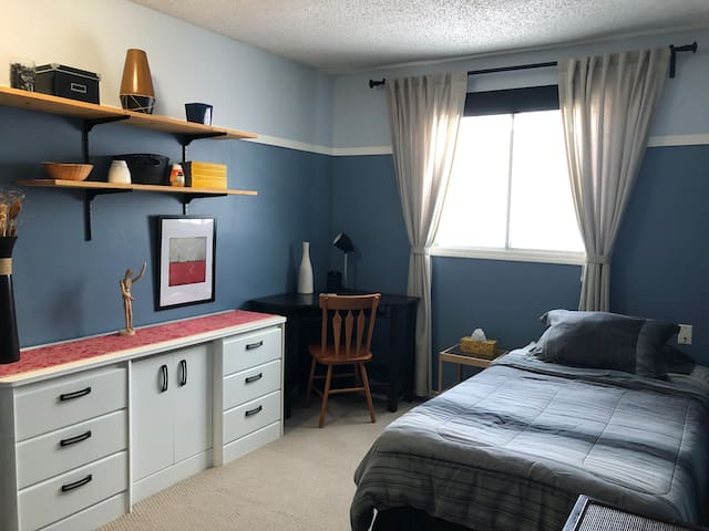 Cozy Blue Room close to West Edmonton Mall.