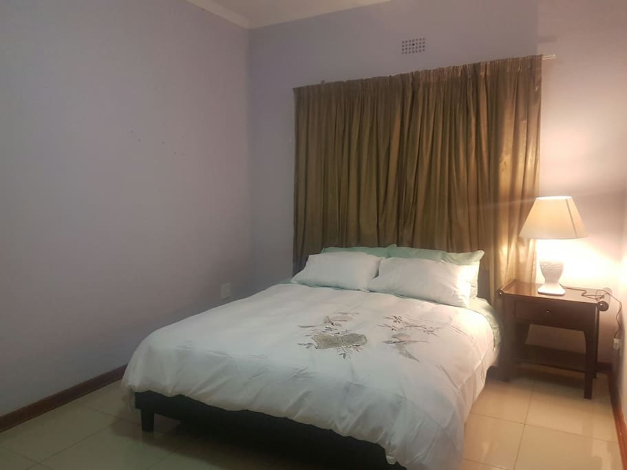 Clean and comfortable bedroom with a queen bed