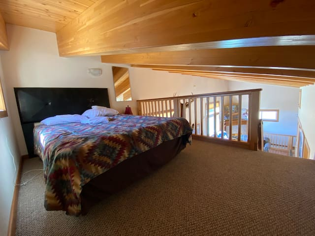 Upstairs bedroom den. One Queen bed. You access this area by climbing up the ladder next to the kitchen.
