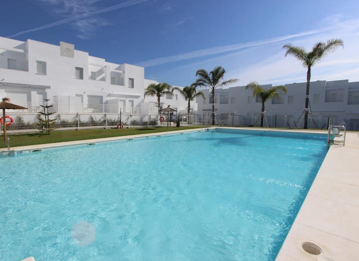 Casa Elena - New modern townhouse with communal pool close to the beach