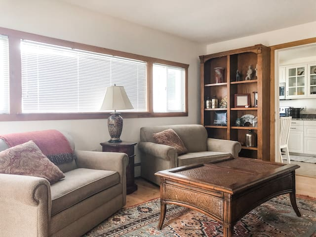 Family loveseats transition into 2 twin beds