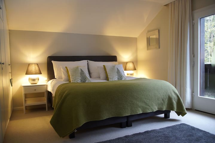 The main bedroom is at the back of the house. There is a large double bed and lots of wardrobe space.  The room-length balcony is a lovely space from which to admire the views of the mountains and listen to the sound of the river.