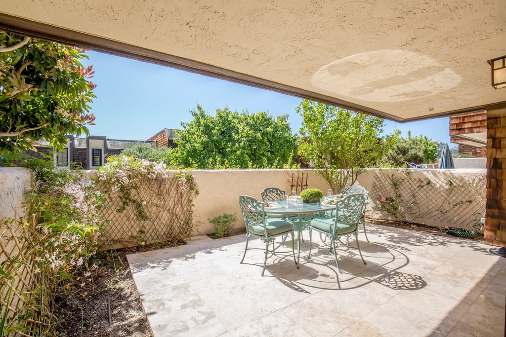 Large Patio area off of Downstairs bedrooms with Patio Table chairs and umbrella.