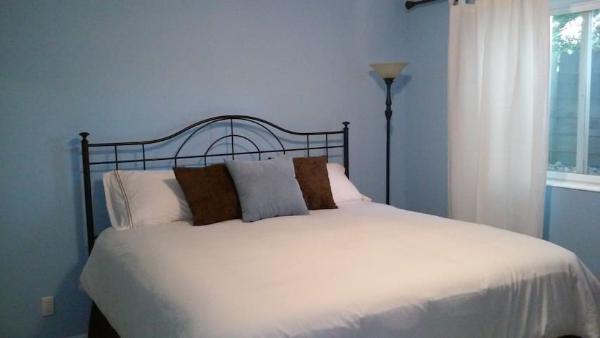 "Enjoy a comfy & cozy king bed and reading lamp in our  ""Something Blue"" room."