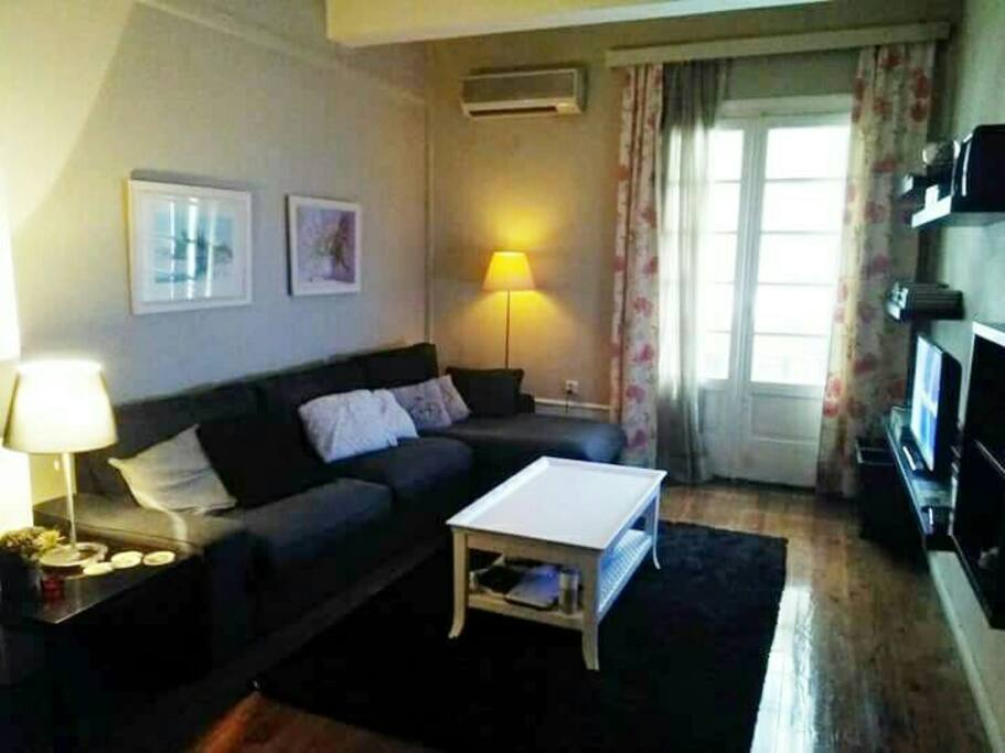 Living room, corner couch, air-conditioned, wooden floor