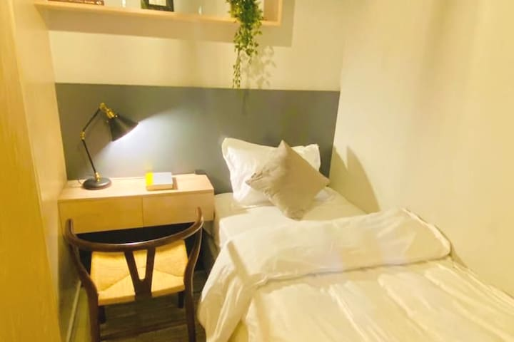 Comfy single bed with working table