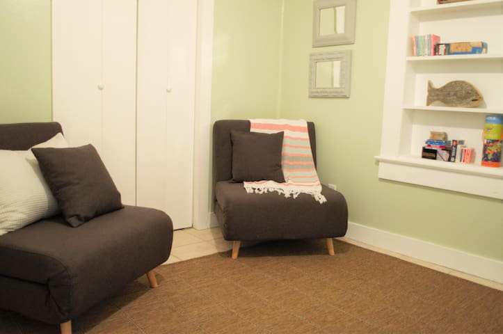 Sitting room chairs convert to single beds. Geared somewhat for kids and stocked with  checkers, dominoes, scrabble, chess and other games and books, adults can enjoy a book or device and relax in this room as well.