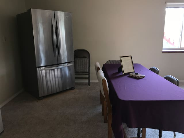 View of dining area and full size refrigerator. Entire area approximately 1000sq ft of living space.