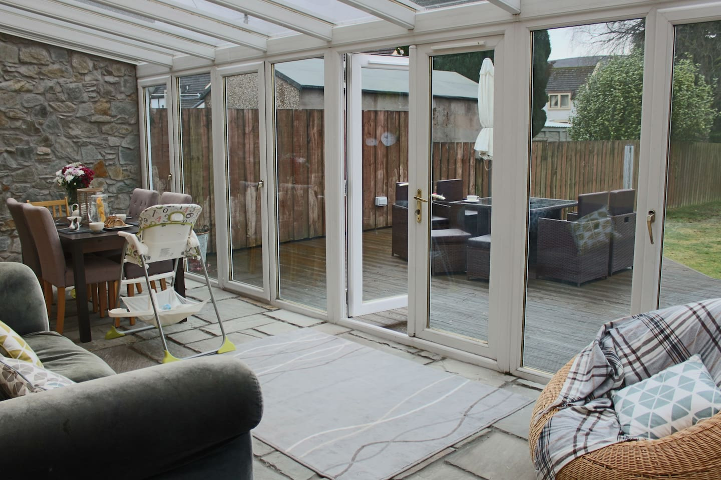 Large conservatory looking onto decking and back garden. Catches the sun in the afternoon/evening so ideal for barbecues!