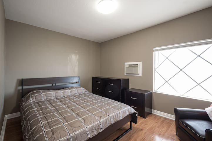 Bedroom with plenty of natural light , you can close the blind for shade.  Comfortable Queen sized bed