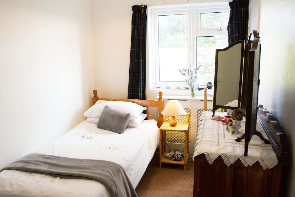 Single room with own adjacent bathroom, view from the bedroom over farmland.