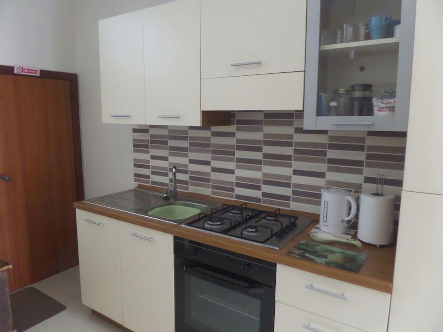Kitchen, washing machine in under stairs cupboard.