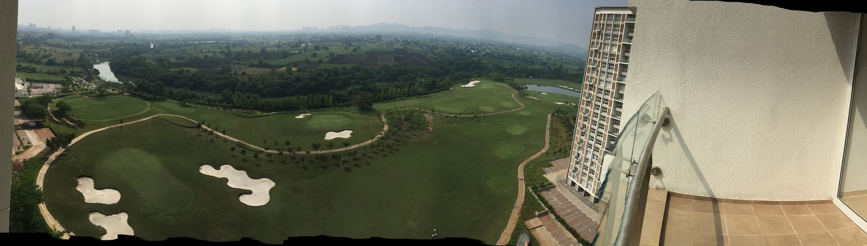 A 3 Bedroom Flat in a riverside complex with a view of Golf Course, River, and the Green Vistas Beyond. (This is a panorama photo - best viewed on mobile)