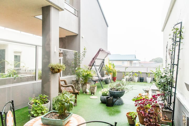 Reading/coffee balcony. Swing seat. Garden and pond.