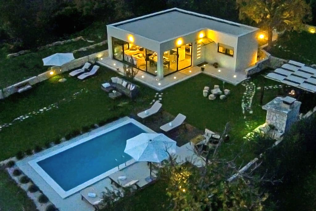 Villa exterior by night in Split on large private land