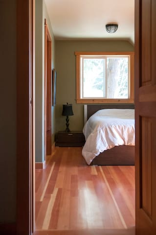 Master bedroom with queen sized bed and ensuite bathroom.