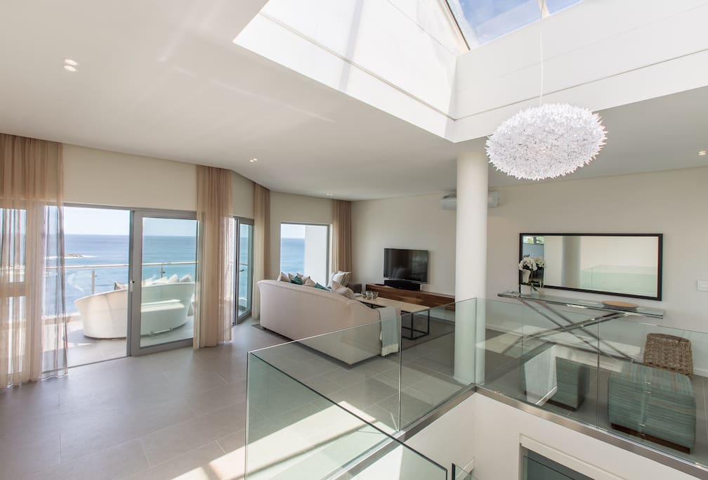 Entrance hall and formal lounge great you with sweeping views of the Atlantic