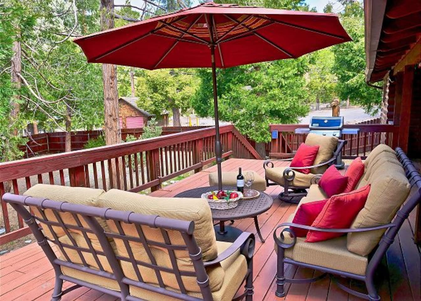 Large deck with plenty of seating and a propane BBQ