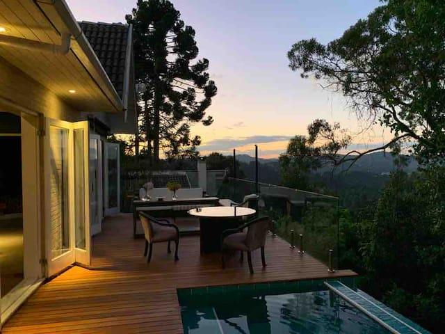 Casa com vista e jardim