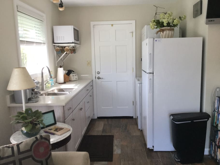 Kitchenette with full size refrigerator, microwave, toaster, k-cup beverage brewer, indoor grill, single burner stovetop, double sink, utensils, dishes, and linens provided.  Washer/dryer too!
