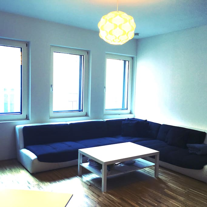 living room with huge sofa