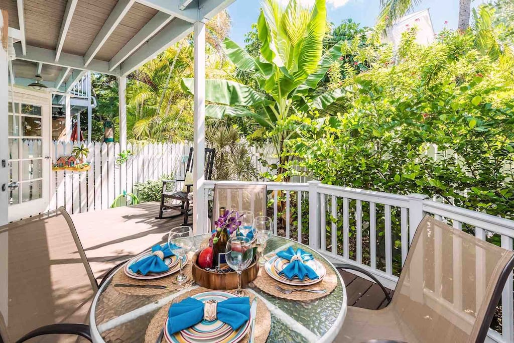 The shaded back patio has a dining set that seats four...