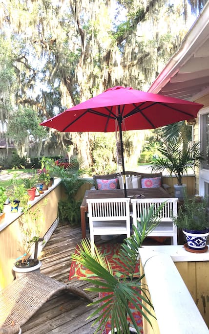 Boardwalk leading from parking welcomes you to the big red umbrella deck to your front door. Table sits 5