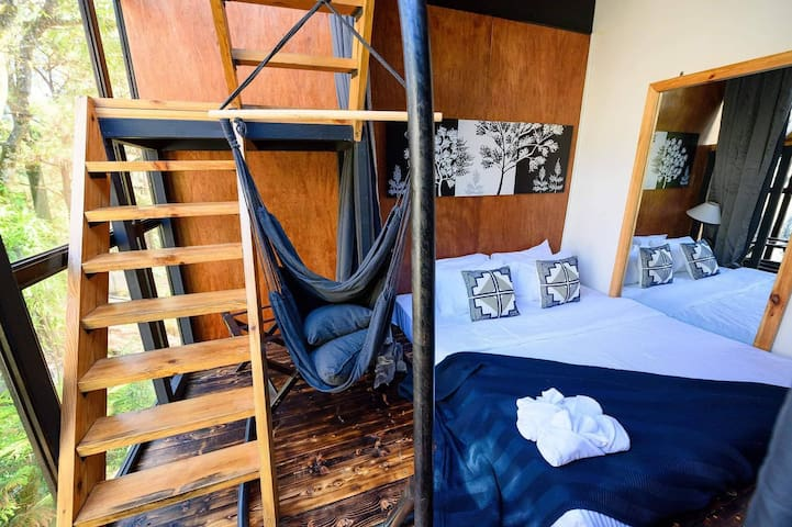 Let's take a look inside the Pine Needle Treehouse. This is the Lower Deck Bedroom of the Treehouse