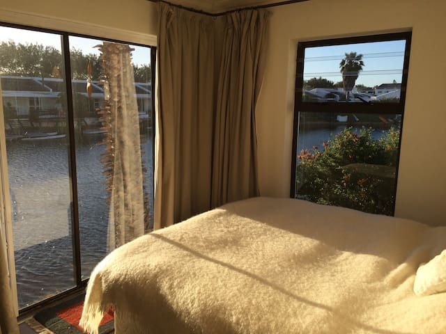 The bedroom is right on the water edge. The morning sun and birdlife will wake you!