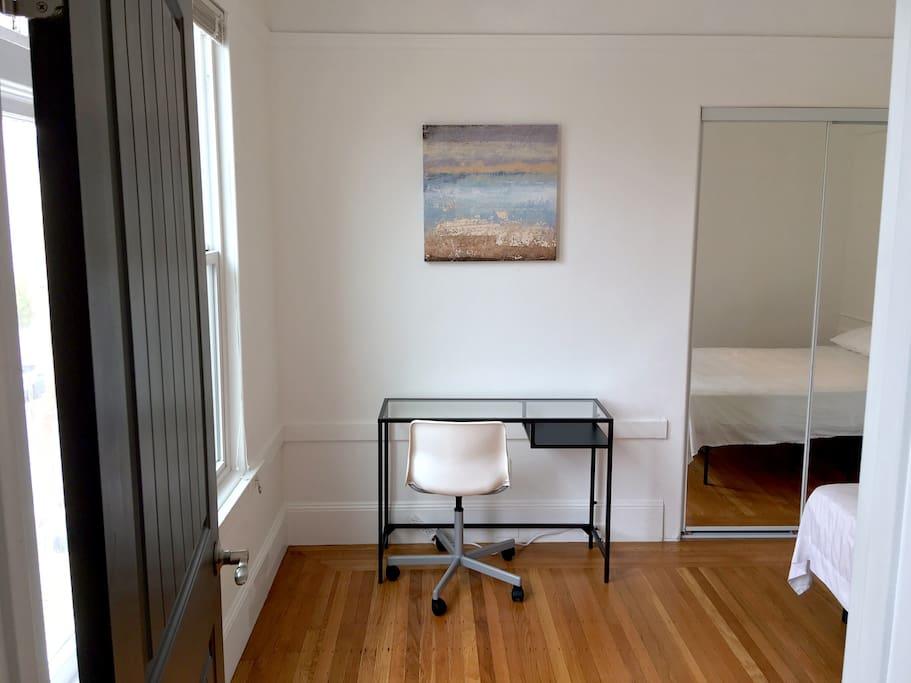 Bedroom has desk workstation