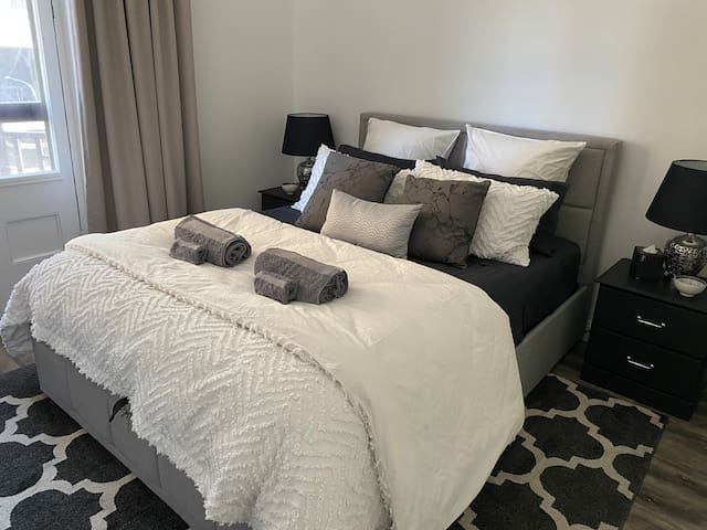 Separate bedroom with heritage Juliette balcony. Queen size bed with Canningvale luxury linen and towels.