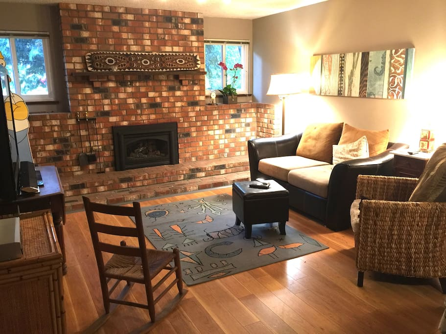 """Large downstairs suite with comfortable living room with gas fireplace, LOTS of books and a 60"""" HD TV."""