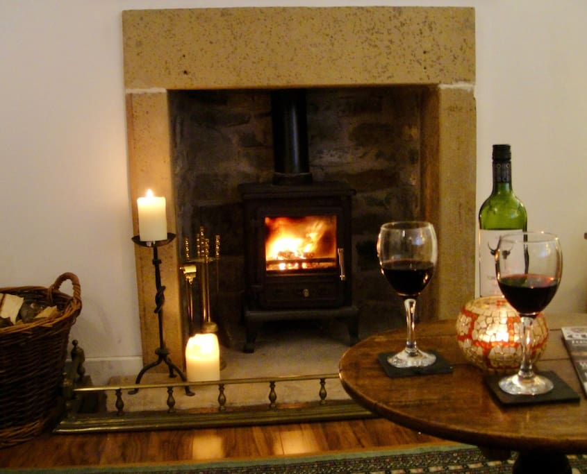 Snuggle up in the evening by candlelight in front of the log-burner, with cosy throws provided.