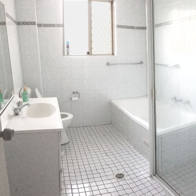 Clean, shared bathroom with bathtub and shower!