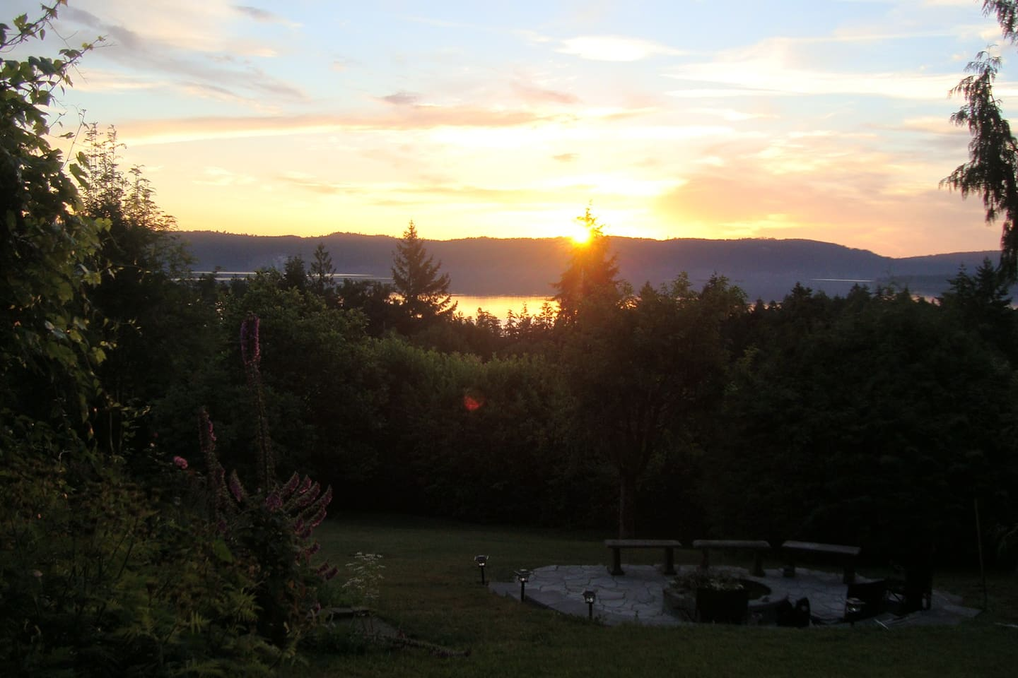 Morning sunrise over Galiano Island from the front deck at Morningside Garden Suite