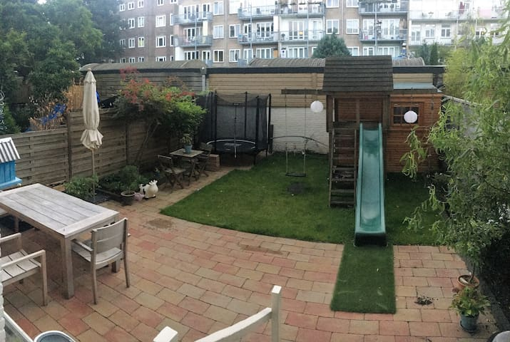 Garden with slide and trampoline