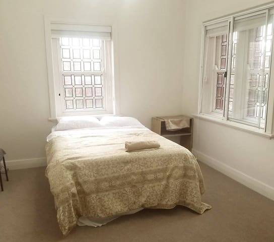 In large beautiful manor -  24 hour parking + pool