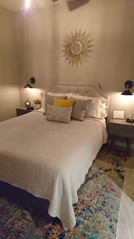 Lovely, comfortable queen bed with nightstands. Beautiful decor.