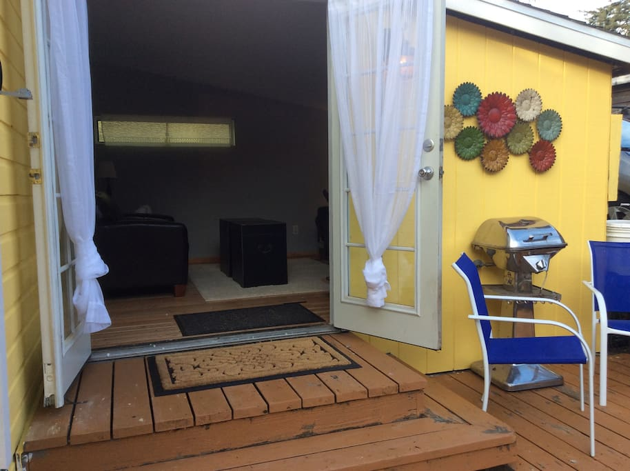 French doors open out to small deck.