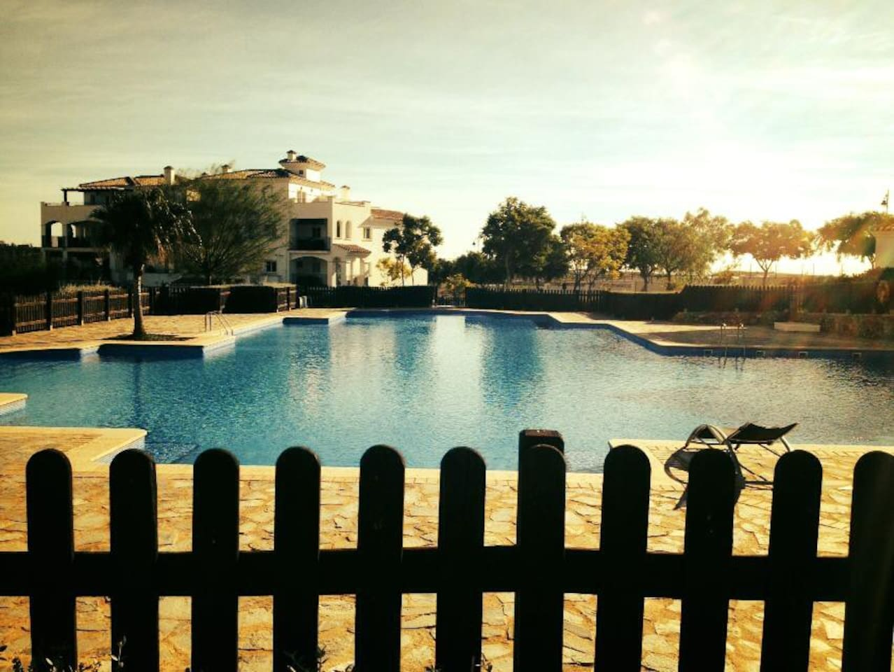 Swimming pool next to the apartment block