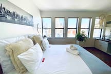 Sweeping city views right from bed.