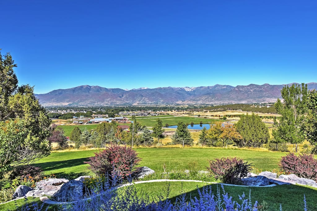 The expansive property is surrounded by breathtaking mountain views.