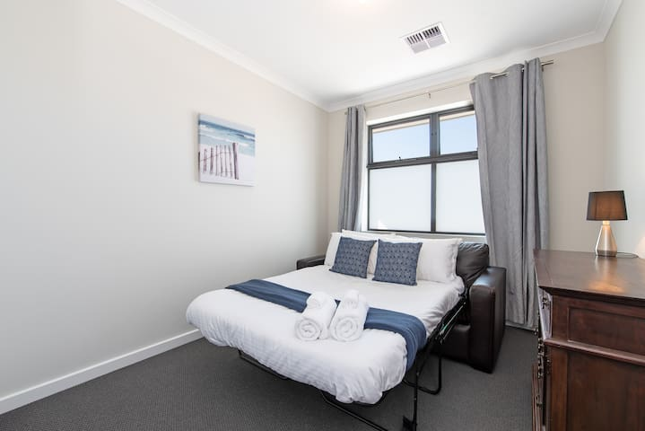 The third bedroom has a double sofa bed with a comfy mattress topper, as well as a built-in wardrobe