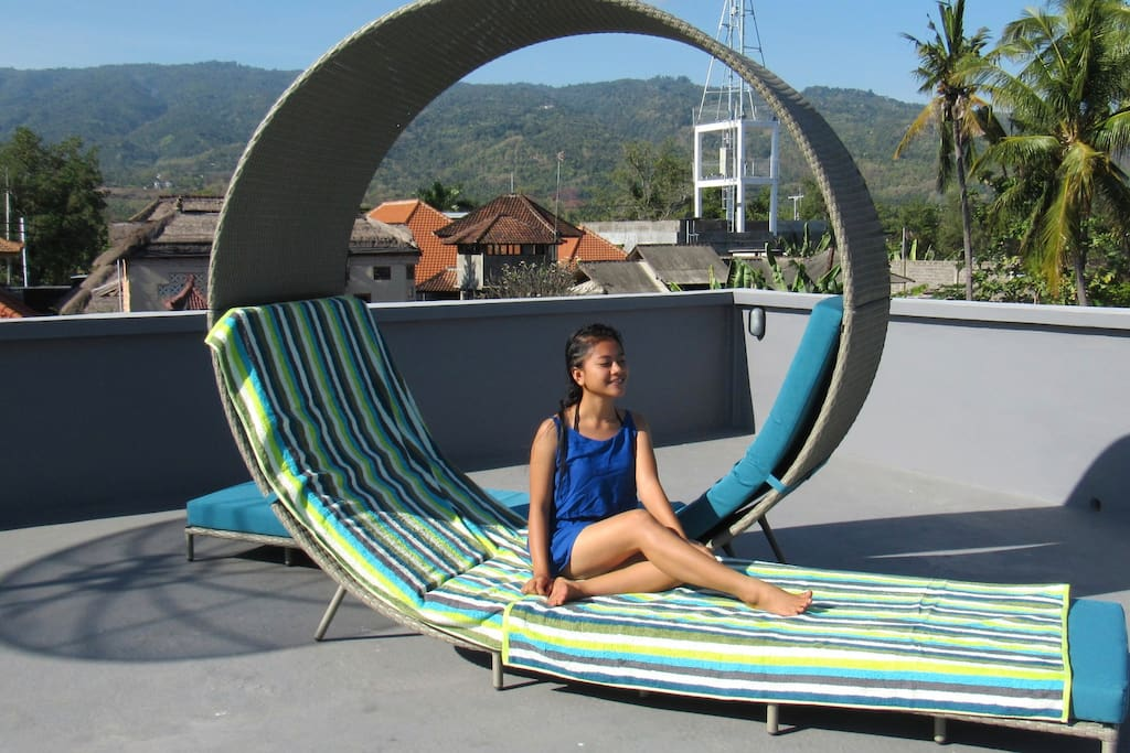 Relax at our sunbeds with a soft sea breeze