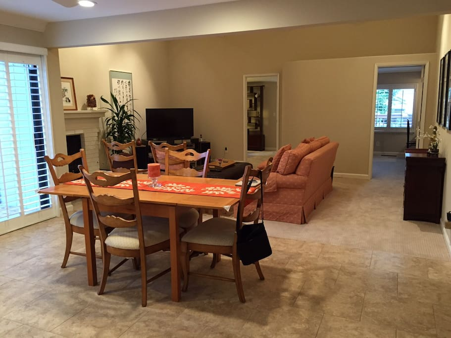 Large open living area with dining table which seats 6.