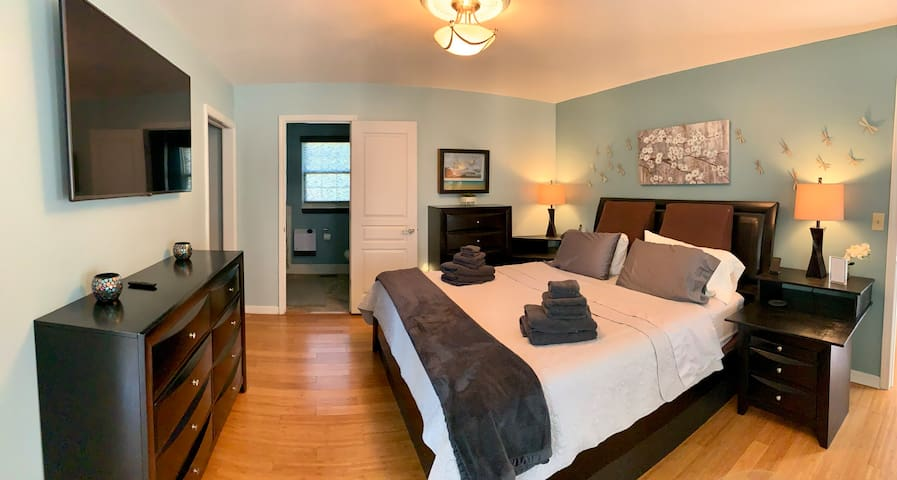 Large room with sitting area. King bedroom and double double beds share bath.   Front load washer and dryer located in closet.