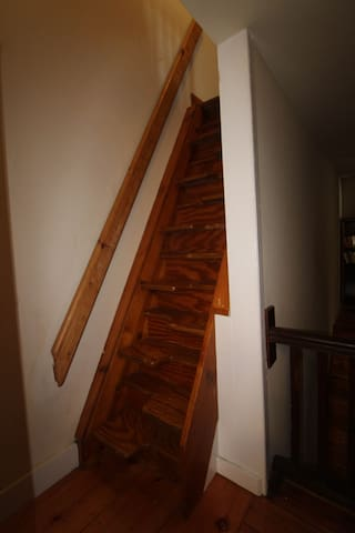 Space saver stair to attic bedroom