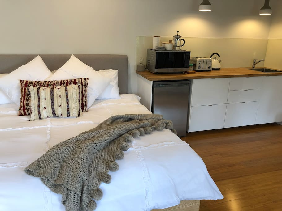 King size bed and kitchenette