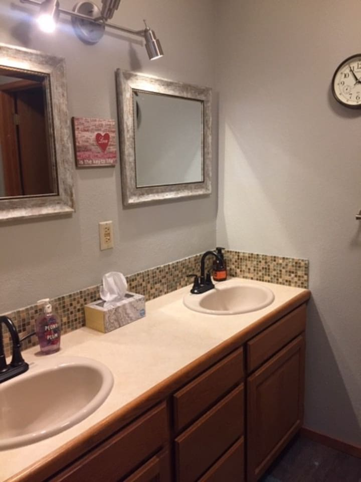 Double sink bathroom with a separate toilet and shower.