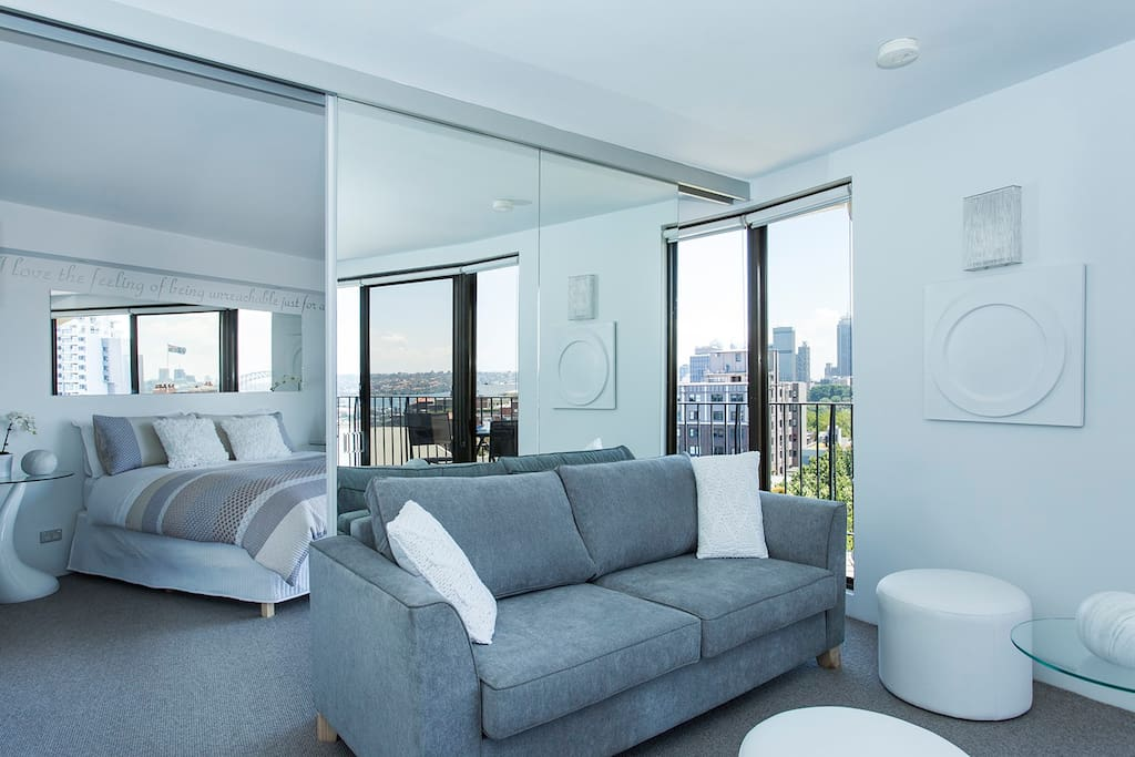 Living, dining and bedroom with 2 balconies. Spectacular views from every angle.